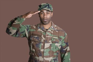 military serviceman saluting, brown background