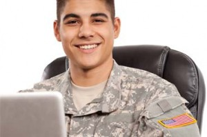 military student smiling behind laptop