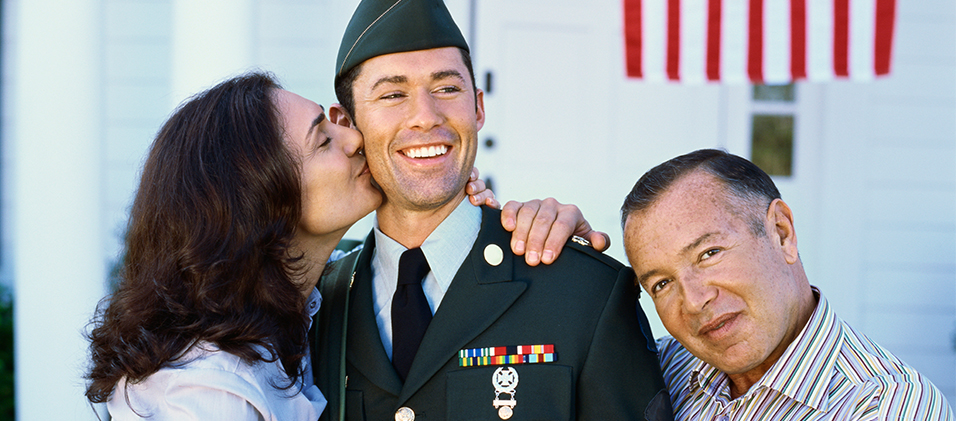 soldier embraced by parents