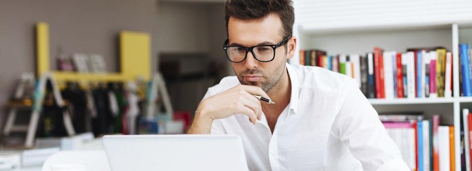 man pondering at computer