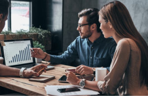 A small team of entrepreneurs evaluate their business plans and future goals. The leader of the group applies the skills she learned online while earning her Bachelor of Science in Business Administration degree at Touro University Worldwide.