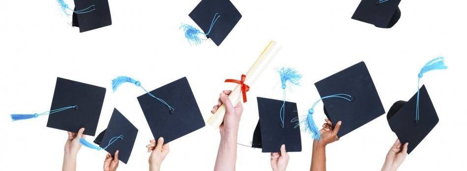 Graduates throwing their caps in the air.