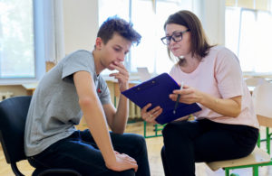 A school counselor helps a high school student deal with difficult emotions.