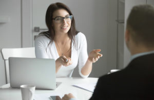 A human resource manager interviews a candidate for a new job opening.