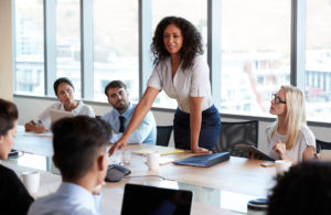 Is a DBA Degree Worth It? Female Business executive running a meeting.