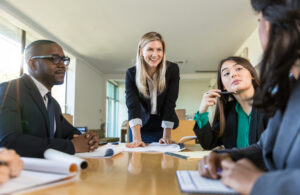 A manager leads a meeting with her team.