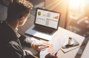 A financial analyst reviews accounting data for his business.
