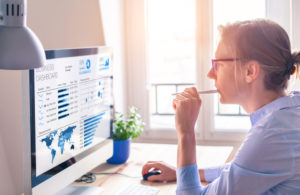 An analyst studies business analytics data to prepare a report for her management team. Study business analytics online at Touro University Worldwide.
